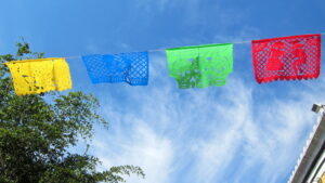 """MX Tlaquepaque - Calle Independencia, Papel Picado is a traditional Mexican craft of decorating tissue paper flags with cut-out designs, today vinyl and mylar are used"""""""